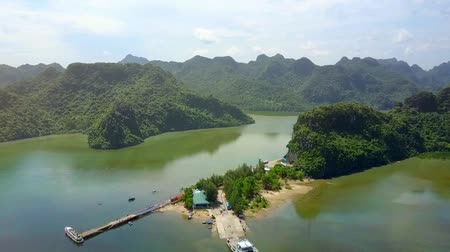 halong : high pictorial aerial view ferry and green hilly islands among tropical ocean in Ha Long bay