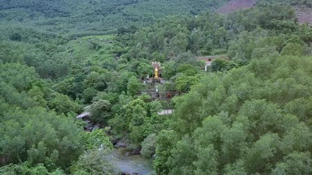 forget : aerial view large gold standing Buddha statue near ancient Buddhists temple mislaid in tropical jungle