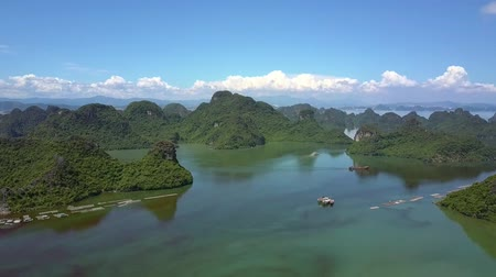 halong : beautiful panoramic view tranquil bay with steep rocky islands and wide blue sky with white clouds
