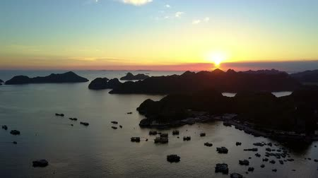halong : beautiful aerial view islands and traditional boats dark silhouettes in ocean bay against sunset