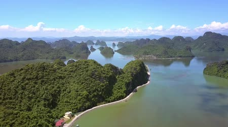 halong : drone descends to forestry hilly island with asphalt road at hill foot Stock Footage