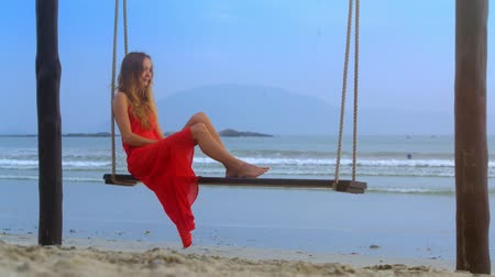 красные волосы : closeup pretty blond haired girl in red dress swimsuit on beach rope bench against pictorial seascape