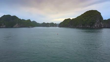 pictured : aerial view small rocky islands azure tranquil water boats and canoe in pictured famous ocean bay Ha Long