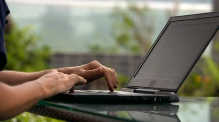 use laptop : closeup man in dark clothes Stock Footage
