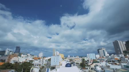 nuvem : timelapse beautiful panorama of modern city with large skyscrapers against sky with white clouds