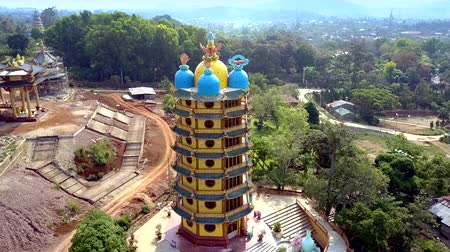 храмы : upper view multistorey pagoda with domes on building site