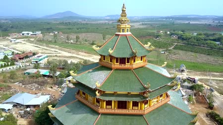 vietnami : close view green roofs of huge temple upper storeys