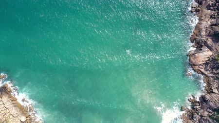 cercar : upper view azure ocean surface surrounded by rocks Stock Footage
