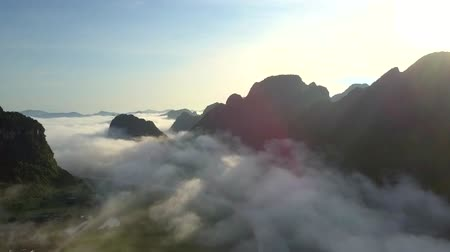 vietnami : boundless highland valley landscape covered with fog