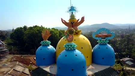 çok katlı : close colourful pagoda domes with praying hands in Vietnam Stok Video