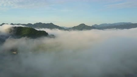 tourist silhouette : breathtaking view tops of mountains protrude from thick fog