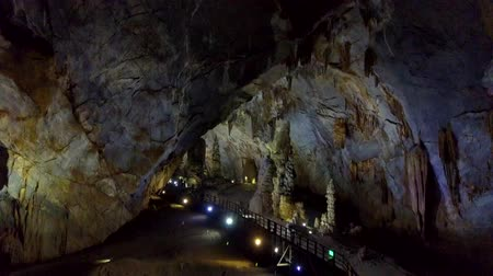 gruta : motion up to cavern ceilings illuminated by colourful lamps Stock Footage