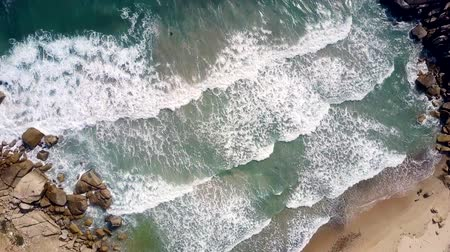 estreito : huge ocean waves roll on beach clutched in narrow passage