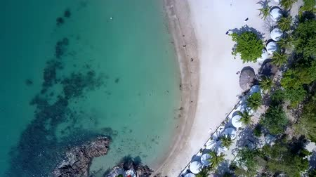 markiza : camera descends close to ocean and white sand beach