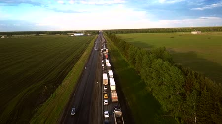 smashing : aerial motion over vehicles row on highway to auto accident Stock Footage