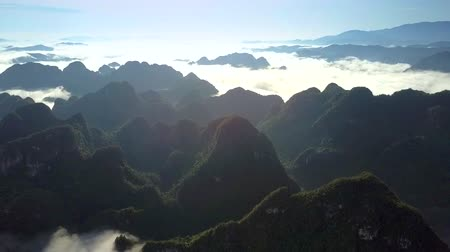tourist silhouette : incredible view mountain tops protrude through white clouds Stock Footage