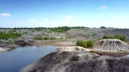 old pit : aerial old clay quarry with lakes islands and flying birds