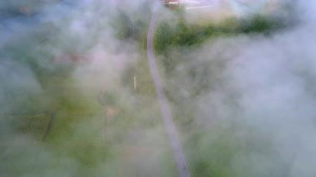 mlhavý : flycam shows scattering fog and visible green valley