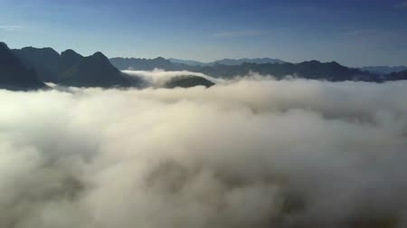protrude : boundless upper panorama hills protrude from thick fog Stock Footage