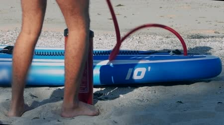 remo : guy pumps fast paddle board through pipe low-angle shot