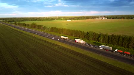 опасность : drone flies above modern highway with traffic jam in country