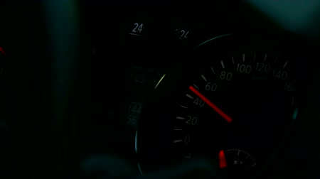 kilometer : glowing car instrument panel with pointers at night Stock Footage