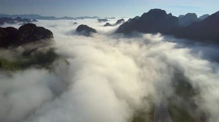 protrude : upper view boundless hills protrude through clouds Stock Footage