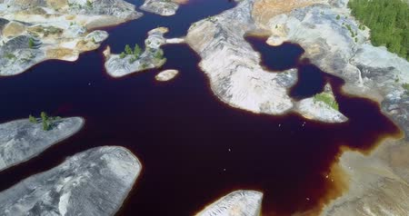old pit : aerial view old clay quarry with flying birds on summer day Stock Footage