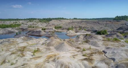lifeless : lake hides behind lifeless clay pit petrified surface