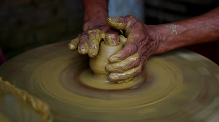 terrakotta : close view skilled asian master makes pot with yellow clay Stock mozgókép