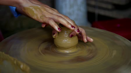 hrnčíř : lady hands make clay pot neck on rotating potter wheel