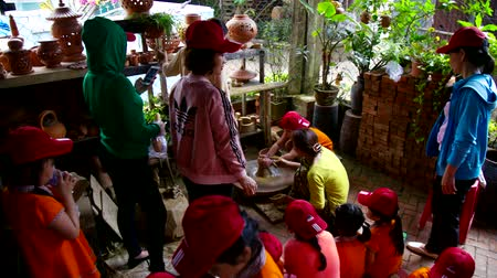 terracota : asian schoolchildren have excursion to pottery workshop Stock Footage
