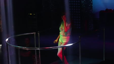lacy : NHA TRANGVIETNAM - JULY 12 2015: Closeup long haired Asian girl singer in lacy top sings popular song dancing in spotlights on nightclub stage on July 12 in Nha Trang
