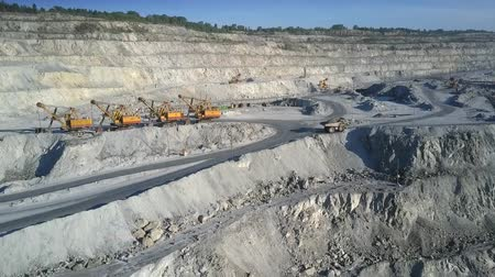 nakládané : fantastic aerial view loaded powerful dump truck removes along upper terrace road on asbestos quarry