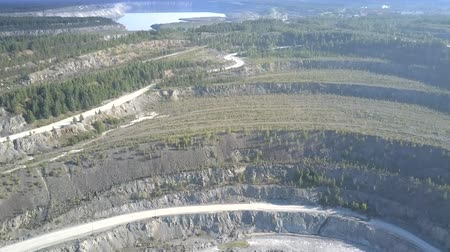 azbest : pictorial aerial motion from old asbestos mining covered with plants and forests to new pit terraces with wide roads Wideo