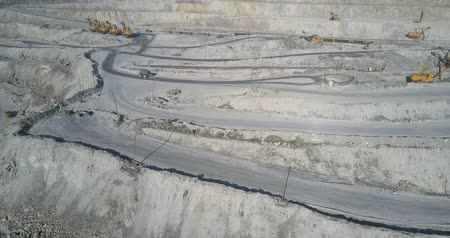 ásványi : beautiful aerial view loaded lorry drives along ground track past mining site with excavators in quarry