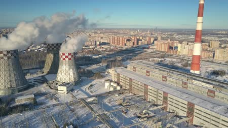 cooling tower : bird eye view heating plant with pipelines and cooling towers against large city and boundless blue sky Stock Footage