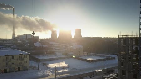 cooling tower : wonderful upper view sun rays break through cooling towers and steam spread over electric power station