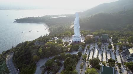 inspirar : inspiring aerial panorama huge buddha statue near temple houses among plants on hilly coast by ocean in Danang