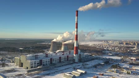 cooling tower : wonderful panoramic view modern heating station with chimney and cooling towers covered with snow