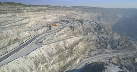azbest : wonderful aerial motion from asbestos pit low level cascade to upper terrace with modern excavators on sunny day Wideo
