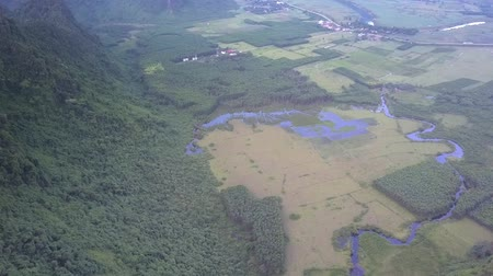 cruzes : blue river crosses accurate valley near high mountain covered with green thick trees and bushes bird eye view
