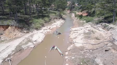 grit : descent to qualified sand miner standing on complicated machine extracting grit from shallow river bottom aerial view. Concept disruption of ecological balance