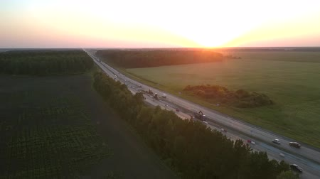 obnova : renewal of highway and driving transport among wide fields and forest in summer evening bird eye view. Concept transportation environment ecology