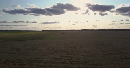inspirar : inspiring panoramic picture large autumn field with modern combine harvester under cloudy sky