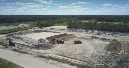 graafmachines : large dump truck loaded with ore by modern digger at sand pit near deep forest aerial view. Concept environmental imbalances Stockvideo