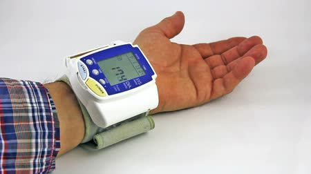 self examination : Man himself measured his own blood pressure on a wrist Stock Footage