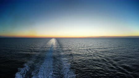 Средиземное море : Water trace behind the large cruise ship on the Mediterranean sea in sunset, 4K UHD