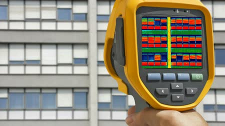 termal : Recording on Residential building with Infrared camera  showing lack of thermal insulation, Full HD video