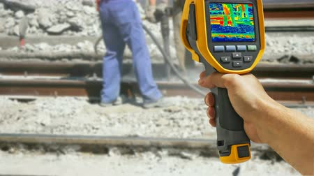 thermography : Recording with Infrared camera Two Workers with pneumatic hammer breaking Concrete at construction site, 4K video
